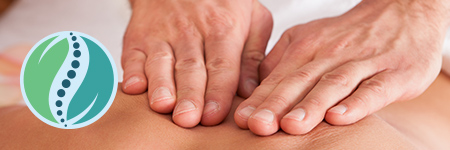 image of hands on person's back for massage or chiropractic